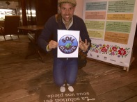 Ryland Engelhart with Soil4Climate sign